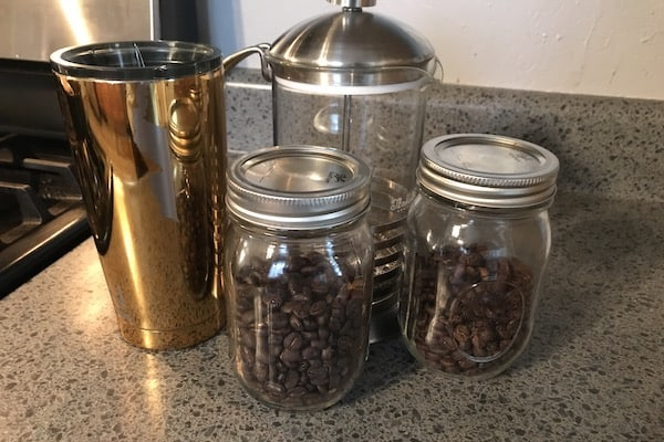 coffee beans, thermos, and french press