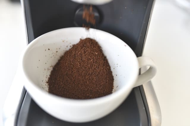 fine ground coffee in a white cup