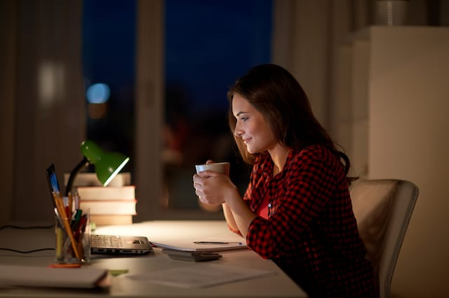 woman at night with coffee